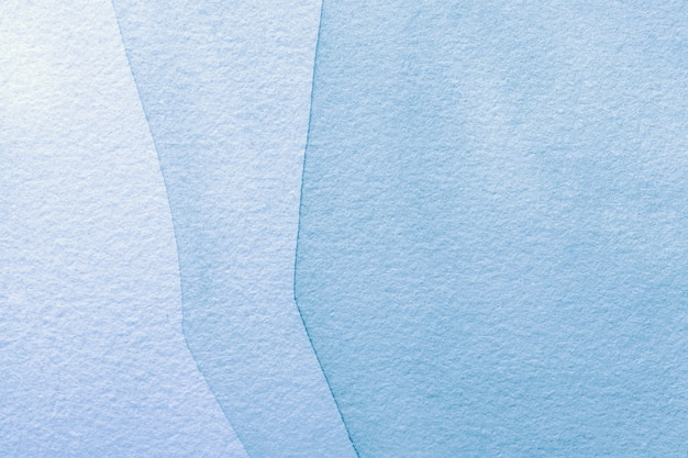 Cores azuis claras do fundo da arte abstrata. pintura em aquarela sobre tela com gradiente de jeans. Foto Premium