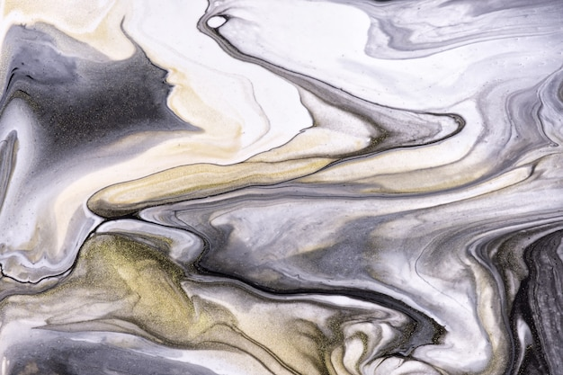 Cores preto e branco do fundo abstrato da arte fluida. mármore líquido. pintura acrílica sobre tela com gradiente dourado. pano de fundo de tinta com padrão cinza. Foto Premium