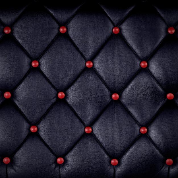 Couro genuíno preto com botão vermelho Foto Premium
