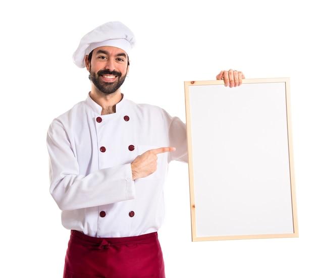 Cozinheiro chefe com cartaz vazio Foto gratuita