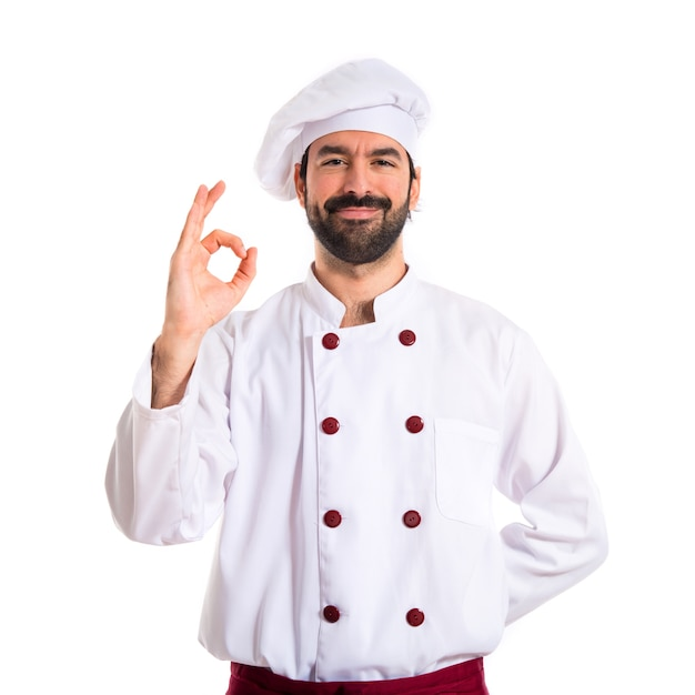 Cozinheiro que faz ok assina sobre fundo branco Foto gratuita