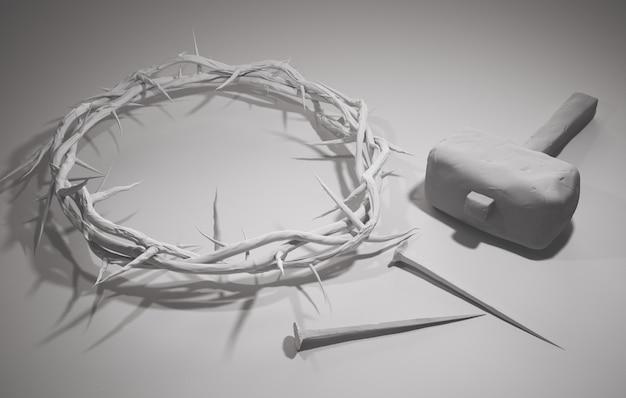 Crucificação de jesus cristo - cruz com martelo unhas e coroa de espinhos renderização 3d fundo branco Foto Premium