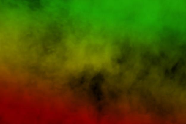 Curvas de fumaça de fundo abstrato e cores de reggae de onda verde, amarelo e vermelho colorido na bandeira da música reggae Foto Premium