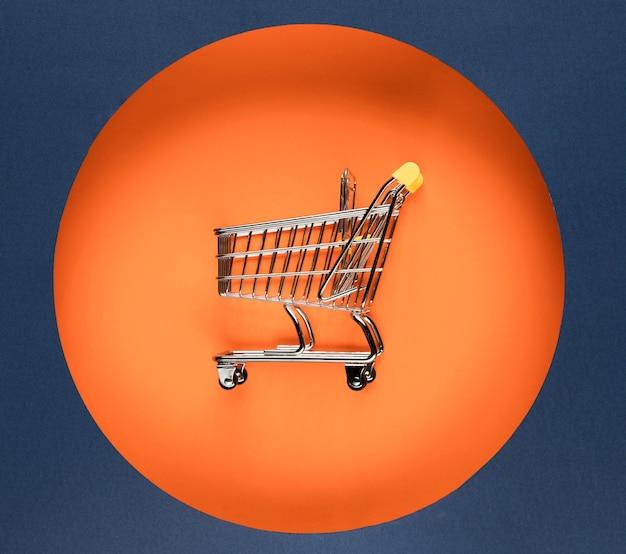 Cyber segunda-feira carrinho de compras laranja círculo Foto gratuita