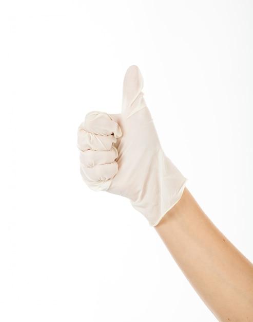 Dando polegar para mostrar sucesso com glaze de látex. a mão direita da mulher é uma boa ideia. Foto Premium