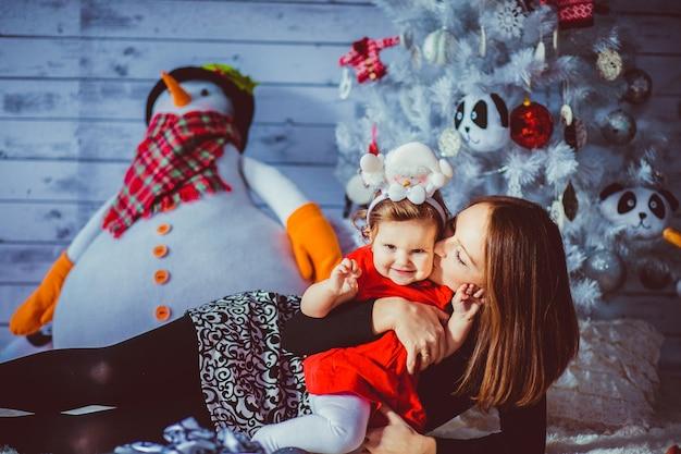 Darkblue mulher mãe snowman indoor Foto gratuita