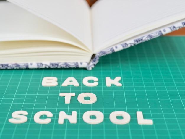 De volta à escola, papel do livro de nota Foto Premium