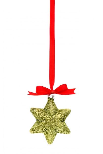 Decorações bonitas do natal com a fita vermelha brilhante no branco Foto gratuita