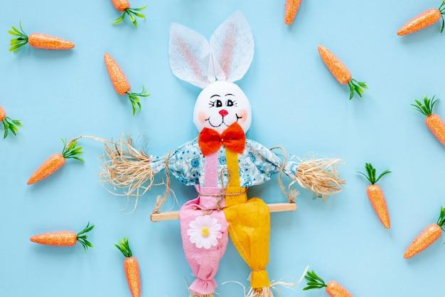 Decorações de coelho com moldura de cenoura Foto gratuita