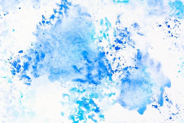 Derramamentos de aguarela azul Foto gratuita