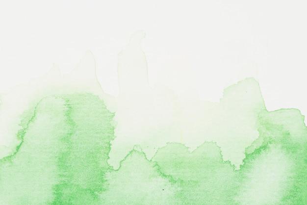 Derramamentos de aquarela verde Foto gratuita