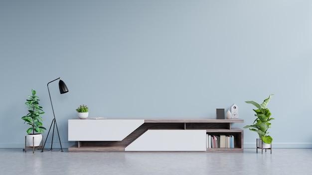 Design moderno de suporte de tv com parede azul com decoração. Foto Premium