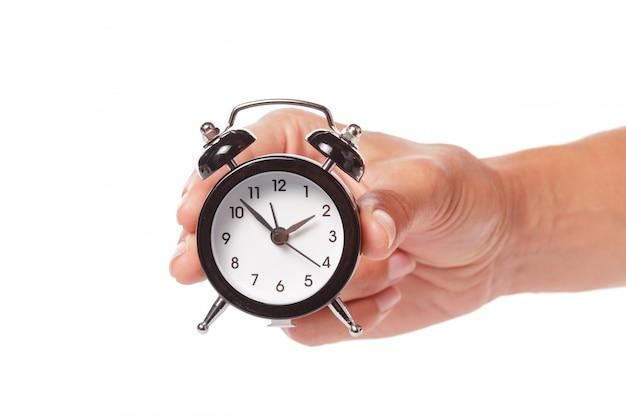Despertador de exploração de mão feminina Foto Premium