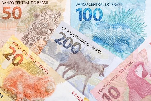 Dinheiro brasileiro um fundo de negócios Foto Premium