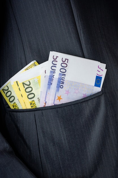 Dinheiro no seu bolso Foto Premium