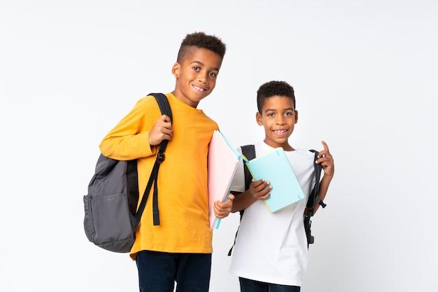 Dois meninos estudantes afro-americanos Foto Premium