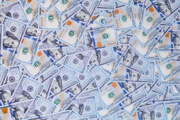 Dólares em fundo branco Foto Premium