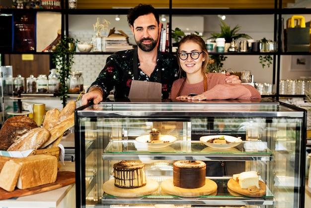 Donos de pequenos negócios bolo café Foto Premium