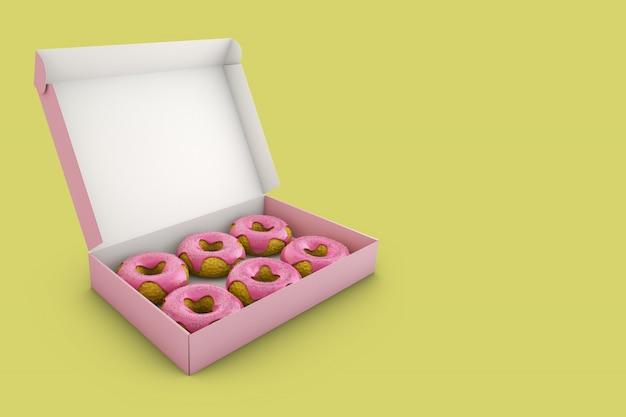Donuts com glacê rosa na caixa. Foto Premium