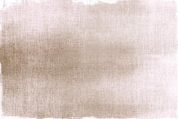 Dourado pintado em tecido texturizado Foto gratuita