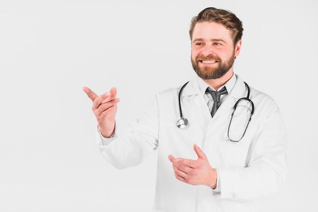 Doutor, sorrindo, e, apontar Foto gratuita