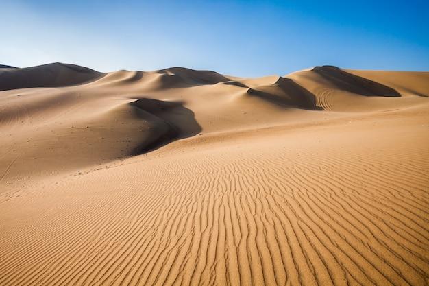 Dunas do deserto de huacachina no peru Foto Premium