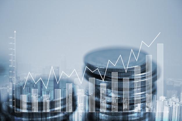 Dupla exposição pilha de moedas com gráfico financeiro Foto Premium