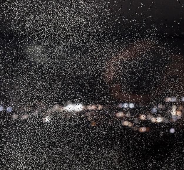 Efeito de chuva no fundo da noite Foto gratuita