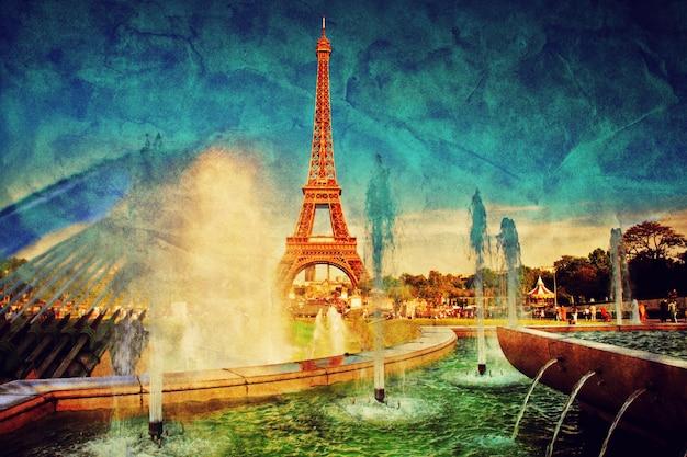 Eiffel towerview através de uma fonte Foto gratuita