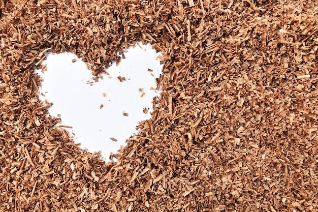 Em forma de coração e madeira vi poeira no fundo branco sujo Foto Premium