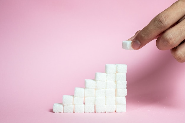 Empilhe os cubos de açúcar de subir para rosa Foto Premium