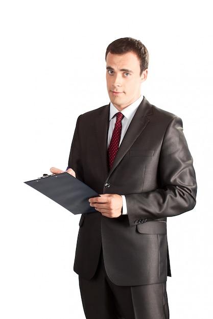 Empresário bem sucedido, escrevendo na área de transferência Foto Premium
