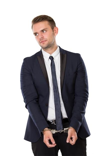 Empresário com as duas mãos algemadas Foto Premium