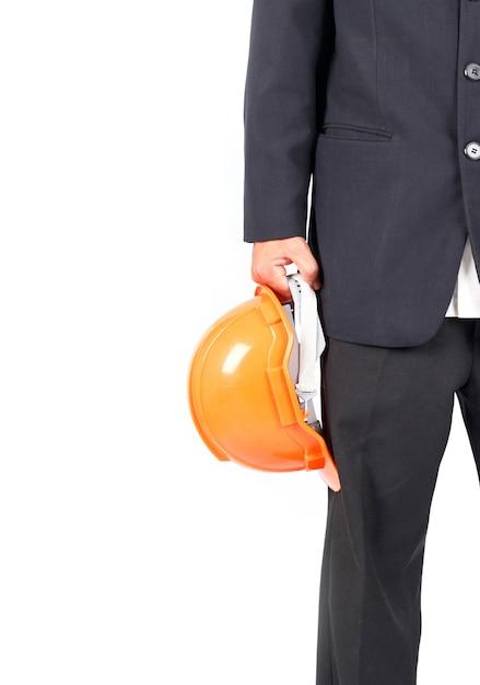 Empresário com capacete de construção. isolado no fundo branco Foto Premium