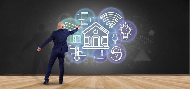 Empresário na frente de uma parede com interface de casa inteligente com renderização ícone, estatísticas e dados 3d Foto Premium