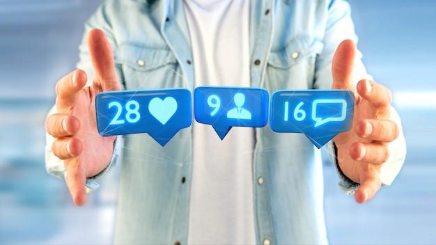 Empresário segurando um like, seguidor e notificação de mensagem na rede social - render 3d Foto Premium