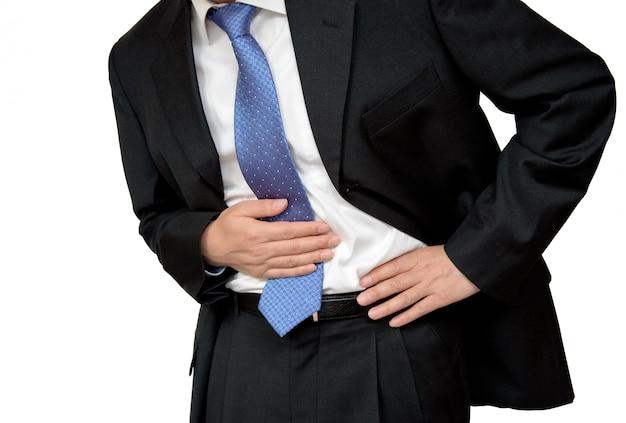 Empresário sofre de dor de estômago. Foto Premium