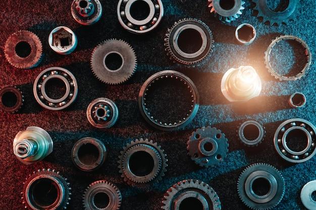Engrenagens e rolamentos em um fundo escuro Foto Premium