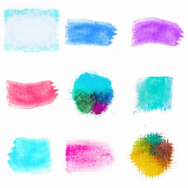 Escovas de composição aquarela colorida Foto gratuita