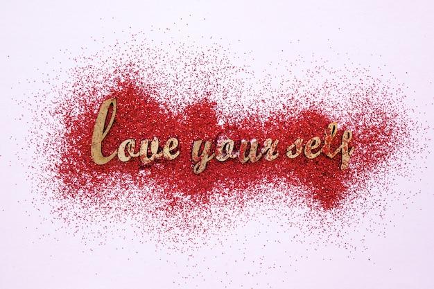 Escrita motivacional no glitter vermelho Foto gratuita