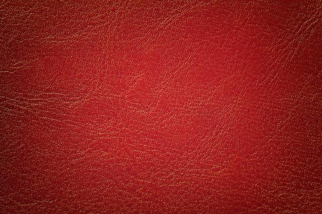 Escuro - fundo de couro vermelho da textura, close up. tijolo rachado pano de fundo da pele de rugas. Foto Premium