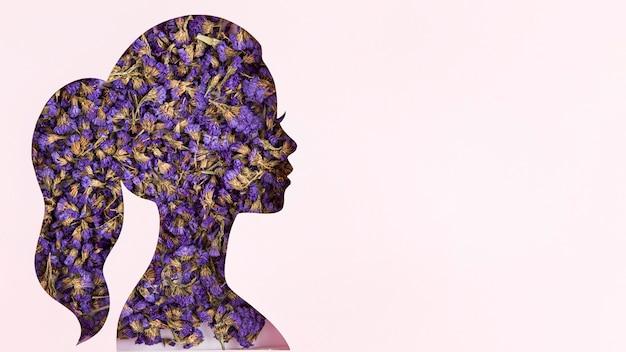 Espaço de cópia floral da forma do retrato feminino para o dia da mulher Foto gratuita