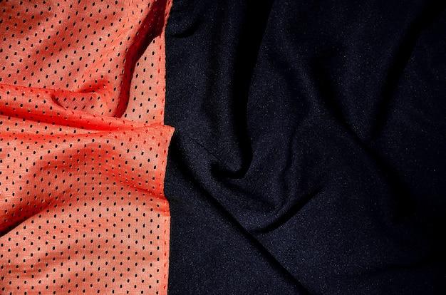 Esporte vestuário tecido textura de fundo, vista de cima da superfície têxtil de pano vermelho Foto Premium