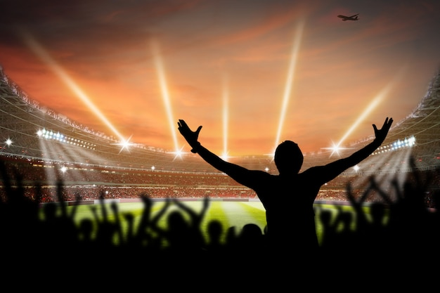 Estádio de futebol à noite com fãs fãs renderização em 3d Foto Premium