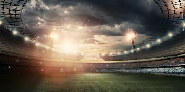 Estádio em luzes e flashes, campo de futebol Foto Premium