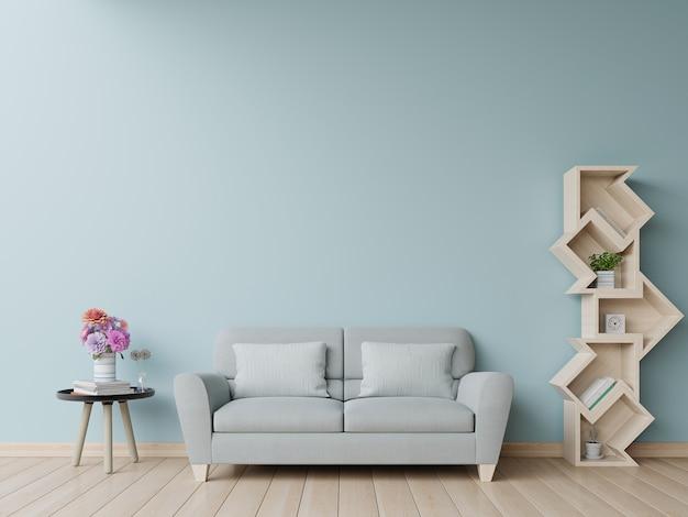 Estante de livros na sala de estar tem sofá e parede azul Foto Premium