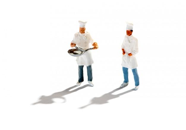 Estatuetas de chefs contra fundo branco Foto Premium