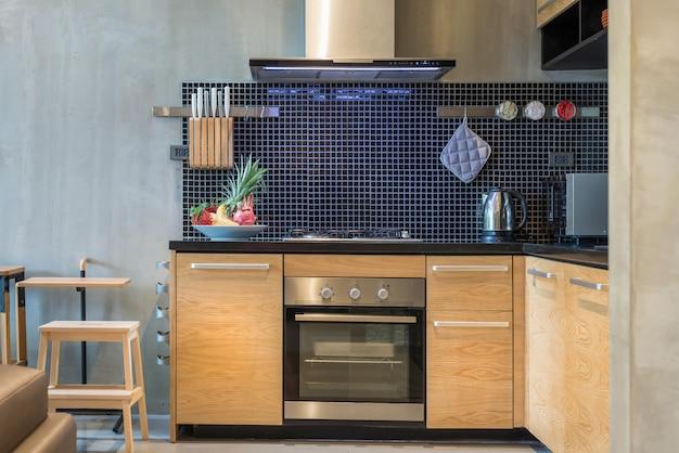 Estilo de design de interiores de luxo loft na área de cozinha com recurso contador de ilha Foto Premium