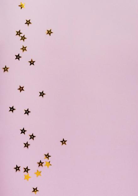 Estrela lantejoulas douradas com espaço de cópia Foto gratuita