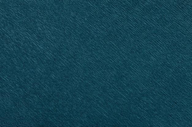 Estrutural do fundo dos azuis marinhos do papel ondulado ondulado, close up. Foto Premium